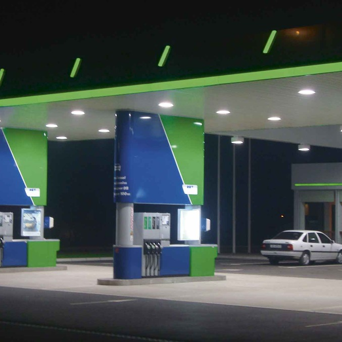 Illuminated advertising petrol stations